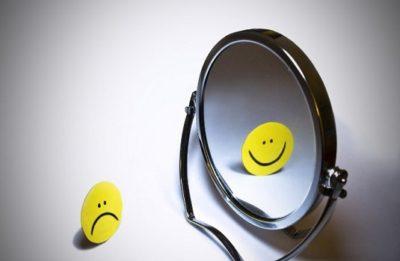 Mirror of Smiling Frowning emoji